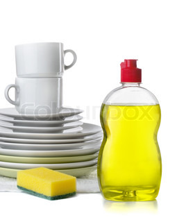 Bottle of dishwashing liquid and stack of utensils isolated on white