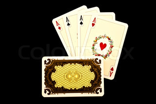 Old playing cards on a black background