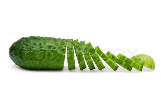 ripe fresh chopped cucumber isolated on a white background