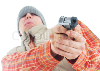 Young man is aiming with gun. Isolated on white.