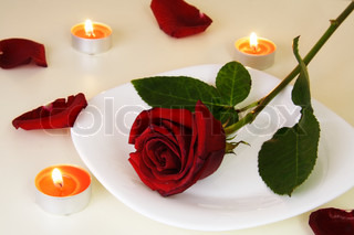 Table Setting with Rose for Romantic Candlelight Dinner
