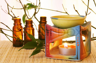 Oil Bowl Burner and Bottles Aromatherapy Concept