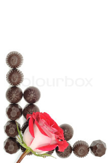 Beautiful red rose and chocolate frame on white background