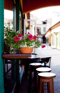 Cafe's chairs outdoors, decorated with flowers