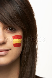 Young Female Sports Fan With Spanish Flag Painted On Face