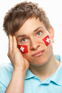 Disappointed Young Male Sports Fan With Swiss Flag Painted On Face