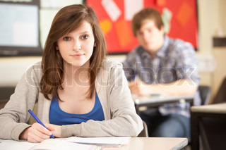Female Teenage Student Studying In Classroom