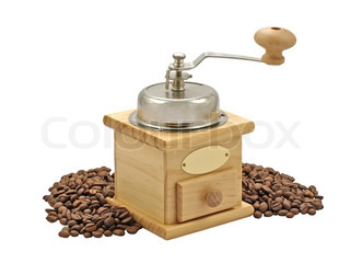 Manual coffee grinder and coffee beans isolated on a white.