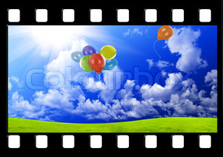 Filmstrip with color balloons in the sky over glade