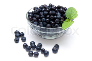 Blueberries in a glass bowl isolated on white background