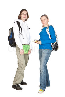 Friendly two high school girl students standing with backpack and notebook isolated on white.