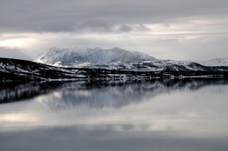 Snowy Mountain Sunshine Reflection with Water and clouds