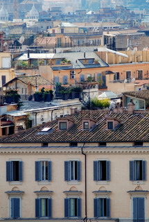 Roofs in Rome from bird's view with facade of the house on the front
