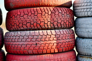 close up of racetrack fence of  red and white old tires