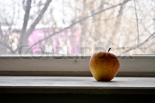 Red apple on a window sill