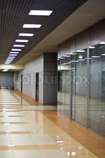 Wall with glass partitions and doors in office building