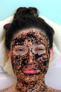 portrait of a smyling  girl in a cosmetic mask of coffee