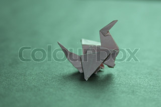 Origami paper crane with shadow