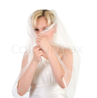 Girl in a wedding dress covers the face veil isolated on a white background.