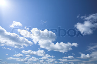 background - blue sky with white clouds high above