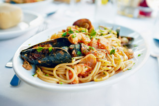 Fresh Seafood pasta - Spaghetti, clams, shrimps and squid, served in a restaurant in Burano, Veneto, Italy.