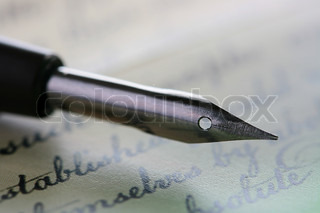 Metal pen for drawing or the letter Chinese ink or drafting ink with a background in the form of the ancient text.