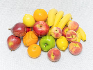 still life of fresh and ripe fruit. bananas, oranges, apples, pears, peaches, lemons and apricots.