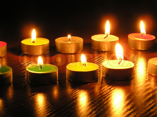 On a photo of a candle as different figures. A photo on a dark background. The photo is made in Ukraine.