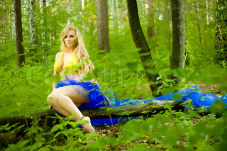 The blond long-haired girl in summer wood