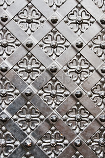 Old door with ornament in stone wall. Royal Wawel Castle.