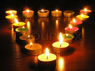 Candles at the form of a triangle