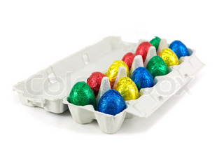 Chocolate Easter eggs in an egg carton isolated against a white background