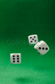 motion dices. Game cubes on a green background
