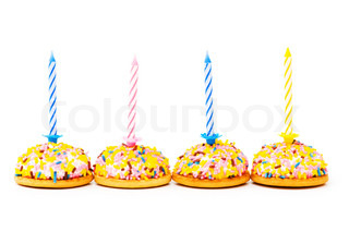 Cup cakes and candle isolated on the white background