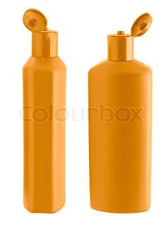 Two orange shampoo bottle. Isolated on white background