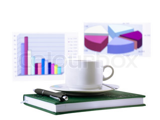 Coffee cup, standing on the personal organizer, financial diagrams . Isolated