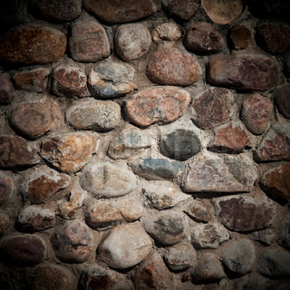 Pattern of old stone wall.
