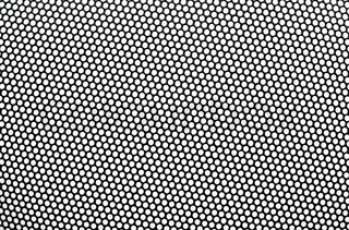 Black metal lattice with round apertures on white background. Close-up.