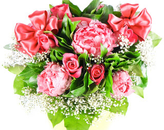 bouquet of colorful flowers with ribbon. peonies and roses