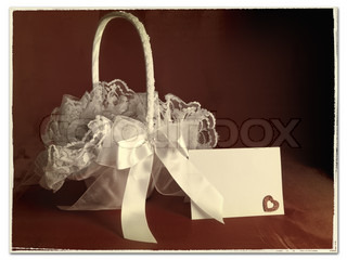 Old (stylized) image of bridal flower basket with invitation card