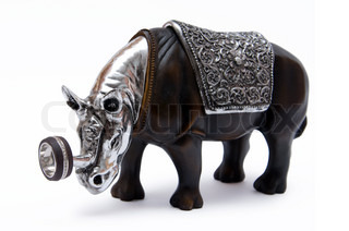 Jewelry holder in the form of wooden rhino isolated on a