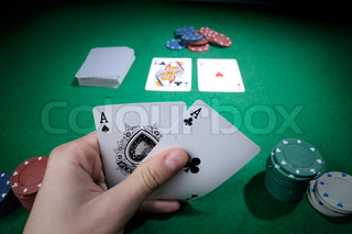 Player hold poker cards with two aces!