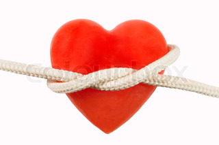 Red heart-shaped candle (symbolizing a human heart) and a rope