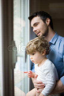 ©Sandro Di Carlo Darsa/AltoPress/Maxppp ; Father and toddler son looking out window, portrait