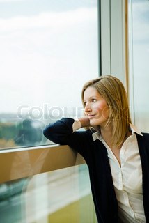 ©Sigrid Olsson/AltoPress/Maxppp ; Woman looking out window, daydreaming