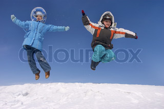boy and girl jumping in the sky