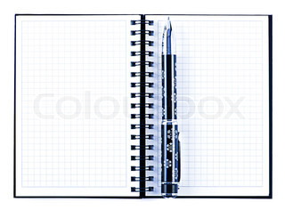 black pencil on open note book