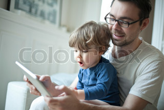 ©Sandro Di Carlo Darsa/AltoPress/Maxppp ; Toddler boy watching father using digital tablet with surprised expression