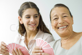 ©Eric Audras/AltoPress/Maxppp ; Senior woman and granddaughter playing cards