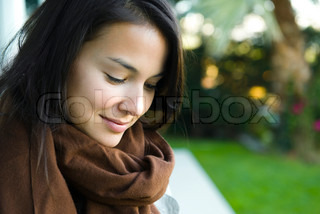 ©Eric Audras/AltoPress/Maxppp ; Young woman looking down and smiling, portrait